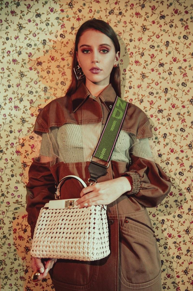 Iris Law shows off Fendi Peekaboo bag in interlocking leather.