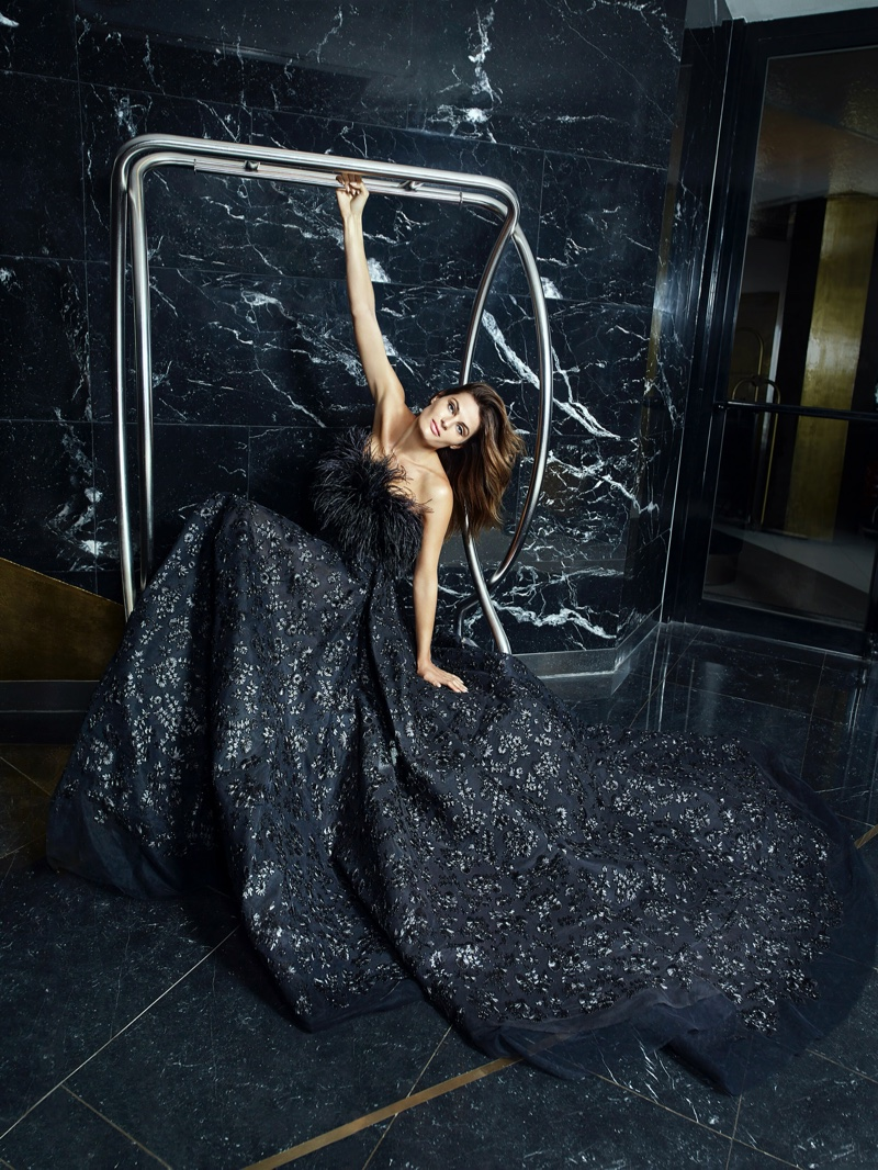 Enchanting in black, Isabeli Fontana models a design from Ali Younes Couture.