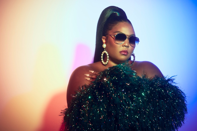 Lizzo poses in Quay Australia Hold Please sunglasses.