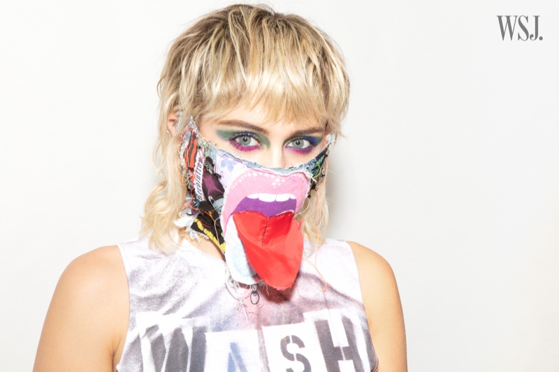 Singer Miley Cyrus poses in a customized face mask.