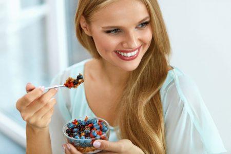 Smiling Blonde Model Eating Fruits