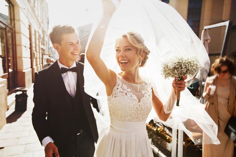 Smiling Married Couple Bouquet Sun Wedding Veil