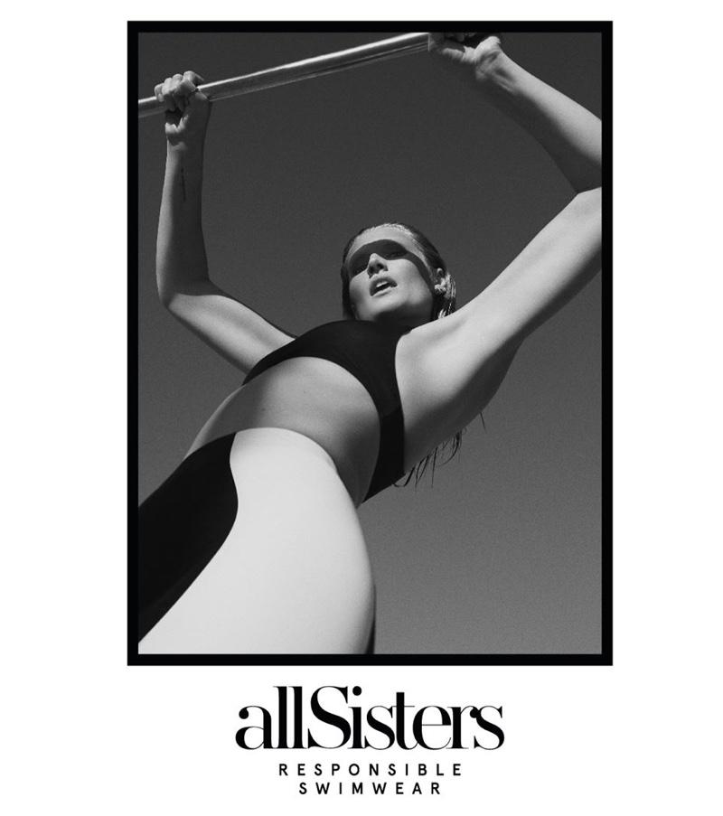 Posing in Venice Beach, Toni Garrn models allSisters Responsible collection.