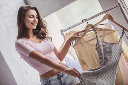 Woman Looking Clothes Trying On Hangers
