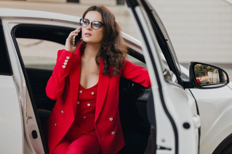 Woman Red Pantsuit White Car Phone Cat Eye Glasses
