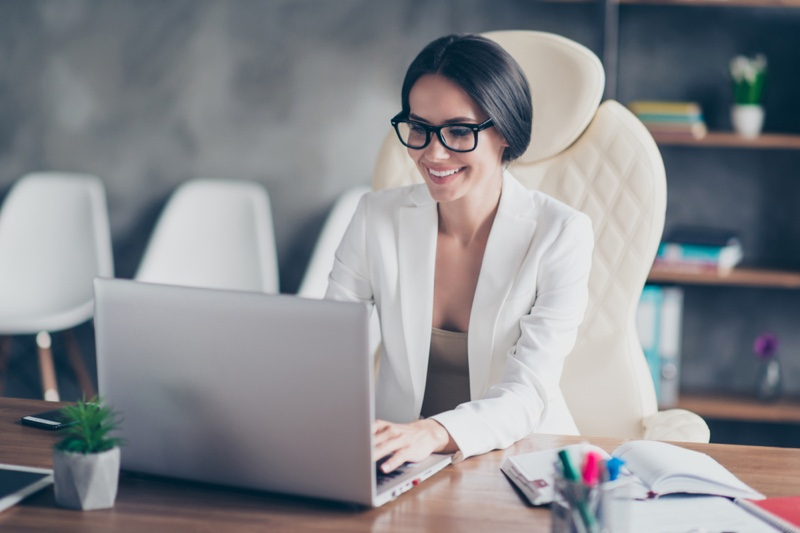 Woman Smiling Desk Laptop Glasses Professional