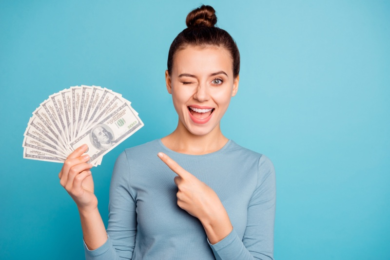 Woman Winking Holding Money Bun