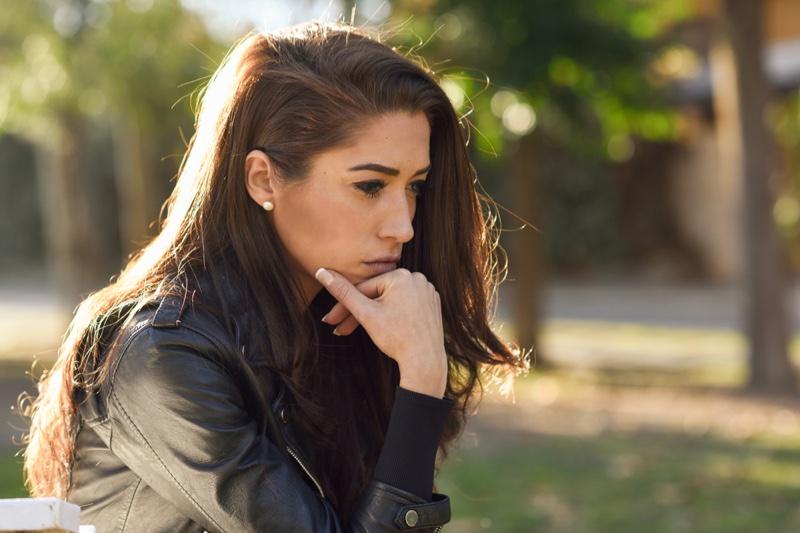 Worried Brunette Woman Leather Jacket Outdoors