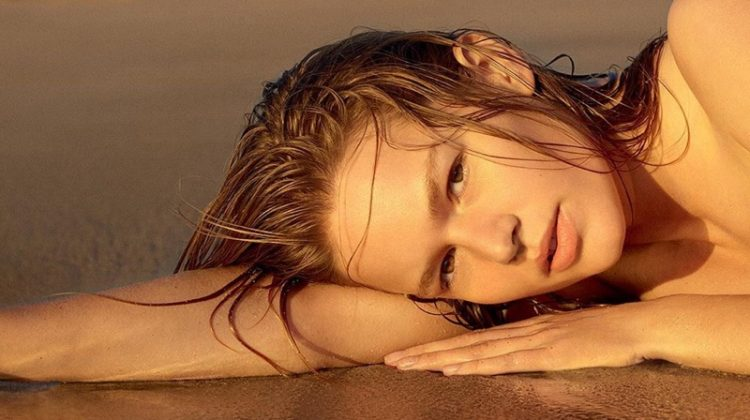 Anna Ewers stars in Jil Sander Sun in a Bottle perfume campaign.
