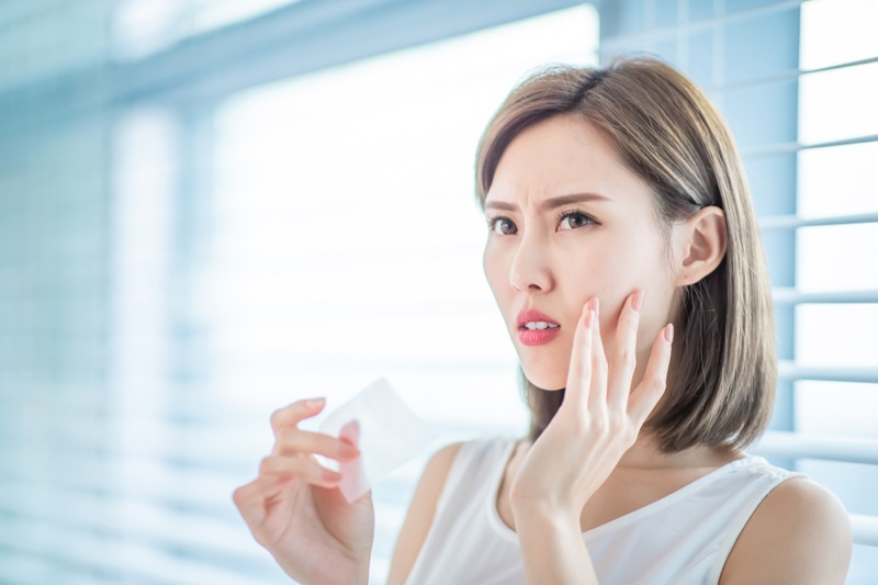 Asian Woman Face Worry Touch Skin