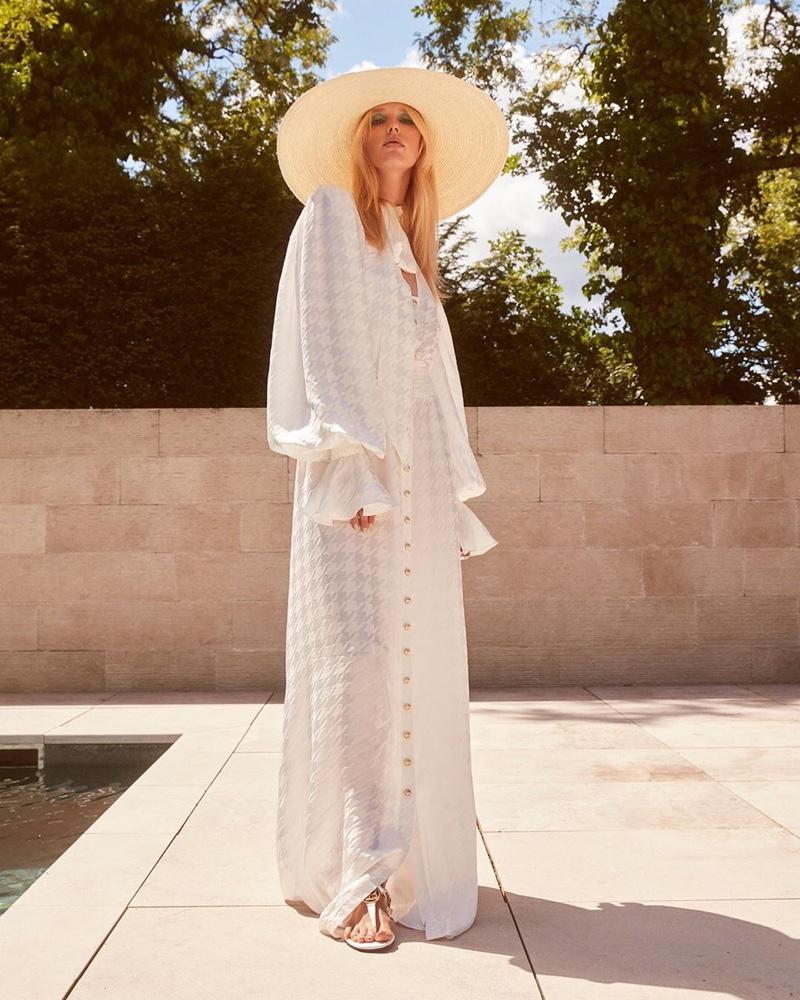 Jessie Bloemendaal poses in Balmain x MyTheresa summer 2020 campaign.