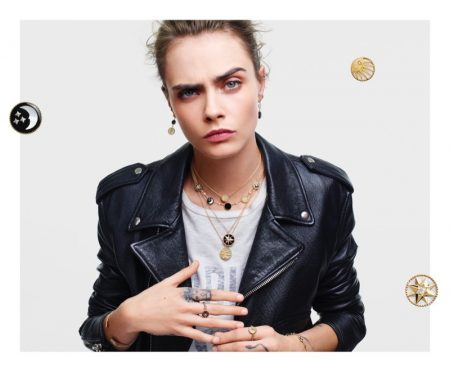 Wearing a leather jacket, Cara Delevingne fronts Dior Lucky Charms 2020 jewelry campaign.