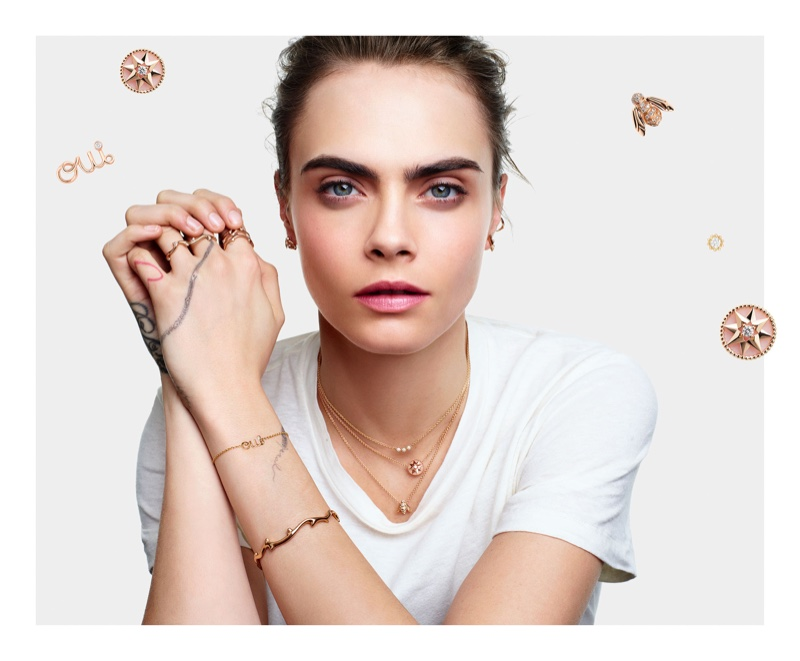 Model and actress Cara Delevingne poses in Dior Lucky Charms jewelry campaign.