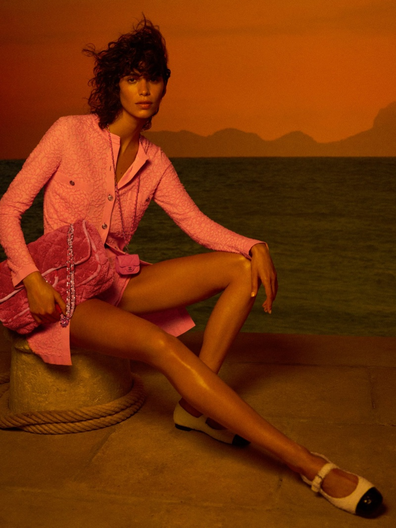 Mica Arganaraz poses in Chanel Cruise 2021 collection.