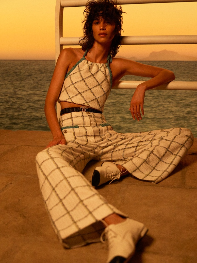 Mica Arganaraz wears checkered print in Chanel Cruise 2021 collection.