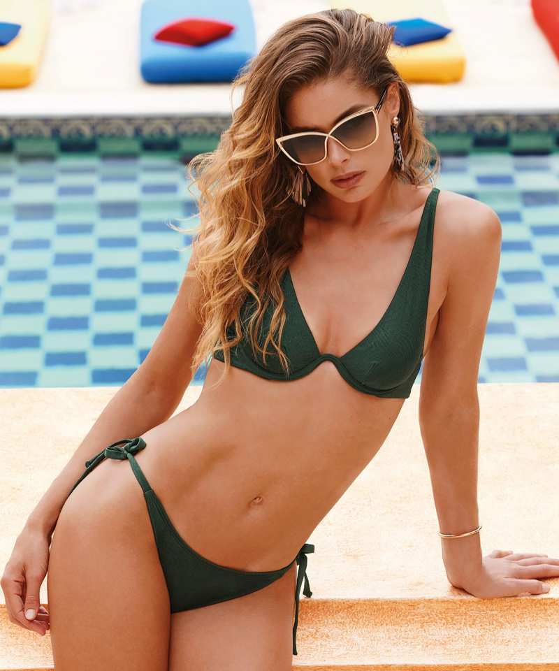 Wearing a green bikini set, Doutzen Kroes poses in Hunkemoller swimwear 2020 campaign.