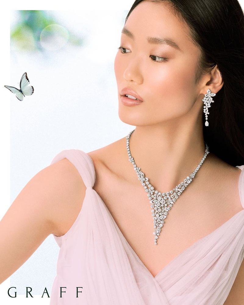 Wearing butterfly accents, Xiaoni Wang poses for Graff Diamonds.