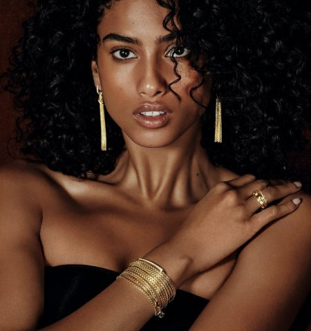 Imaan Hammam shines in gold David Yurman jewelry for Holt Renfrew.