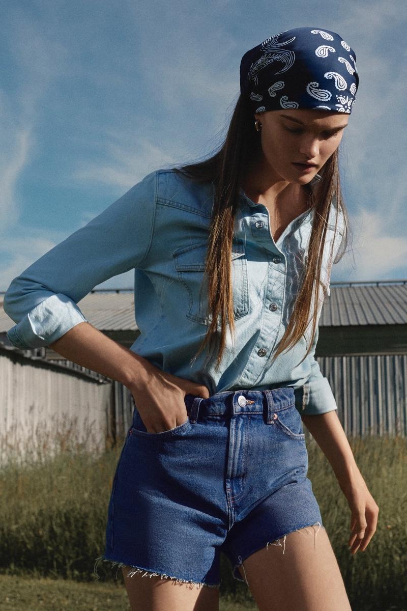 Model Lulu Tenney rocks double denim style from Zara.