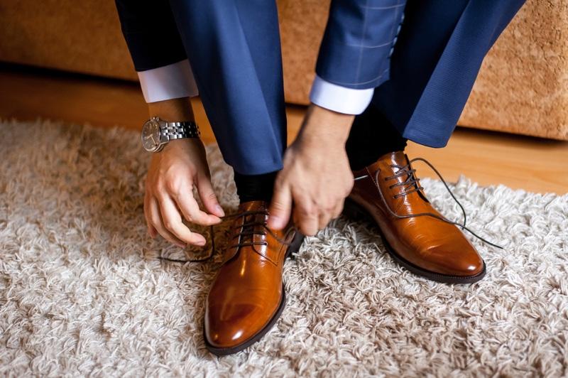 Man Tying Shoes Socks Watch Dapper