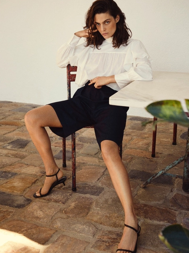 Massimo Dutti Shirt with Ruffle Detail, Navy Blue Pleated Bermuda Shorts and Heeled Strappy Sandals.