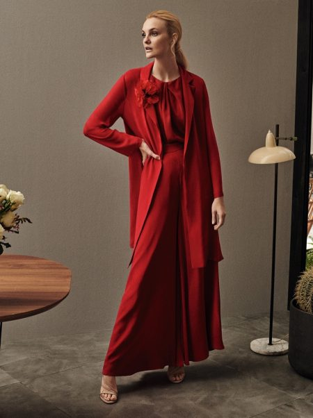 Caroline Trentini poses in all red ensemble for Max Mara.
