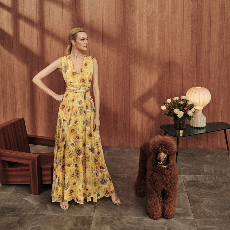 Model Caroline Trentini poses in a floral print gown from Max Mara.