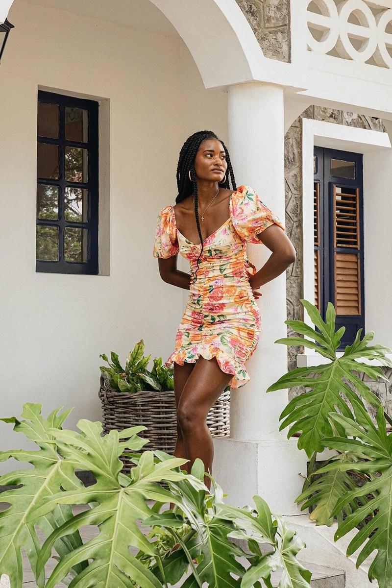 Model Melodie Monrose poses in For Love & Lemons Versilla mini dress.