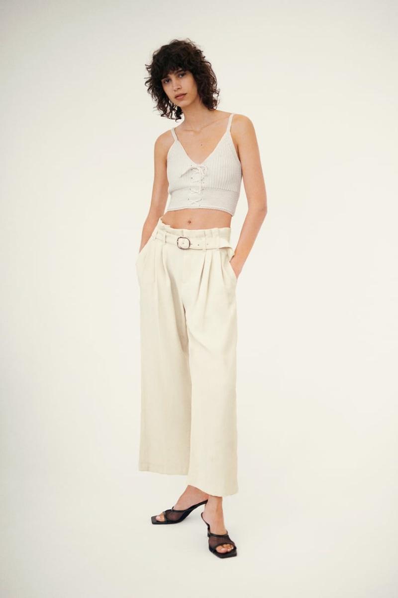 Mica Arganaraz models Zara crop top and wide leg belted pants.