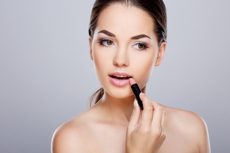 Model Applying Lipstick Beauty