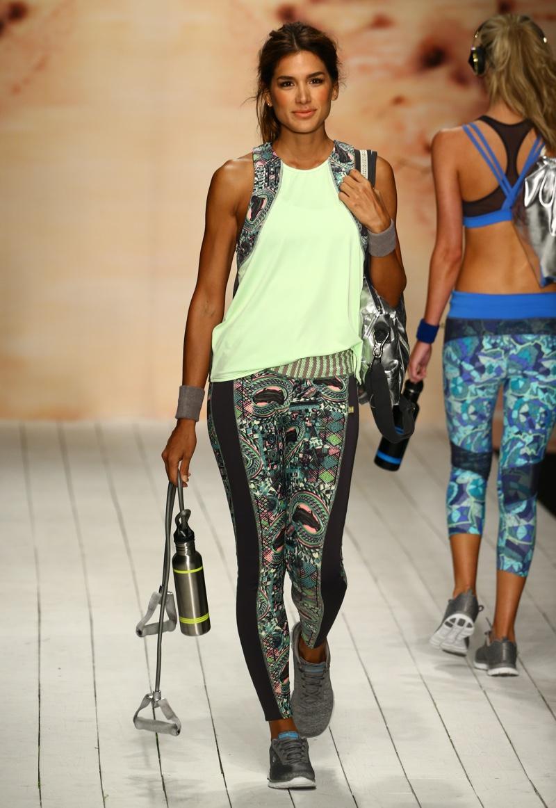 A model walks runway in designer swim apparel during the Maaji Swimwear fashion show.