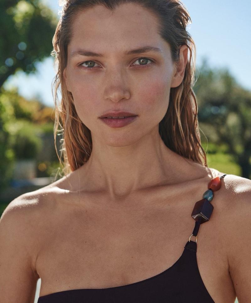 Model Hana Jirickova wears one-shoulder swimsuit from Oysho.