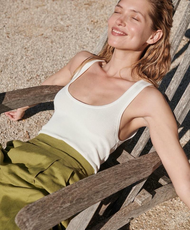 Soaking up the sun, Hana Jirickova poses in Oysho summer 2020 lookbook.