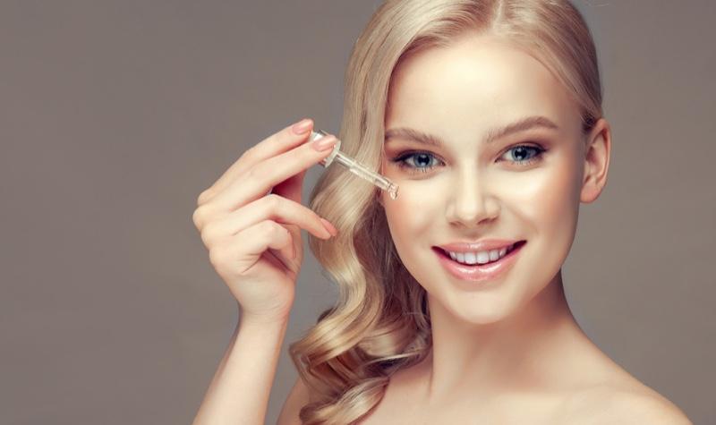 Smiling Blonde Woman Oil Dropper Beauty Skincare