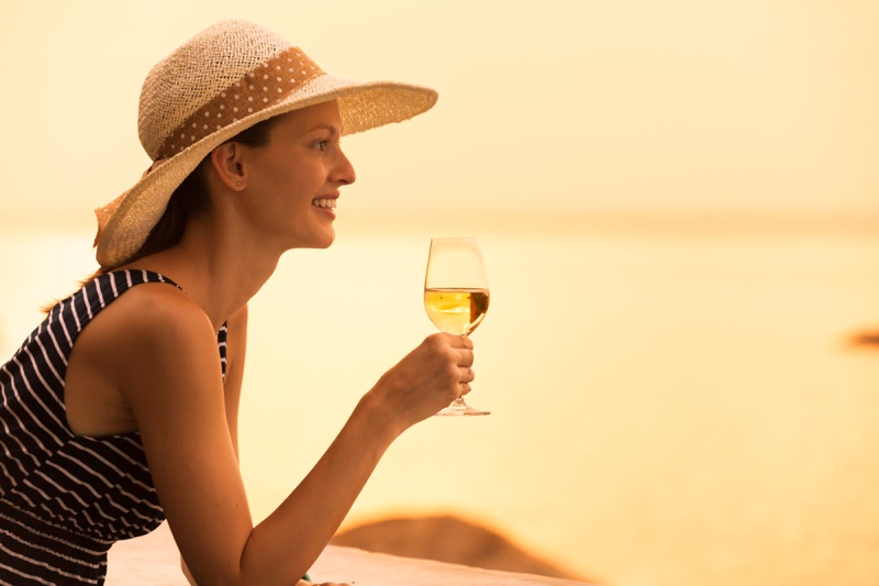 Smiling Woman Holding White Wine Glass Vacation Style