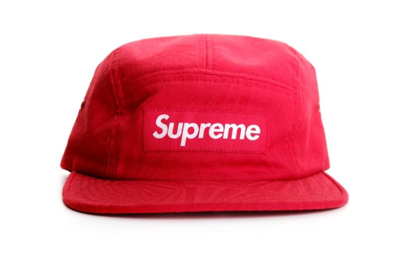 Red Supreme hat.