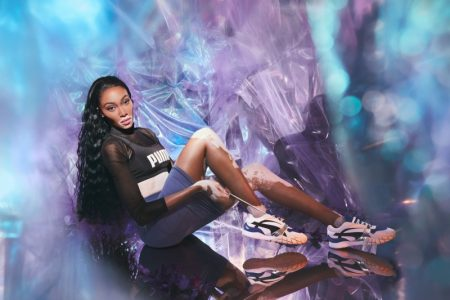 Model Winnie Harlow poses in PUMA Kyron sneaker campaign.