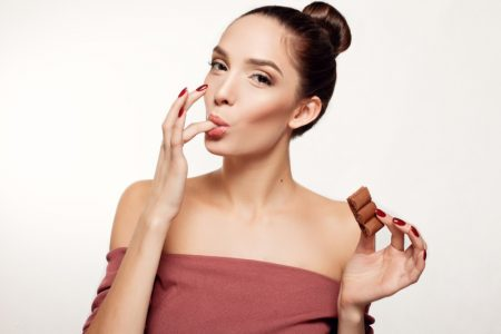 Woman Eating Chocolate Bar Happy Licking Finger