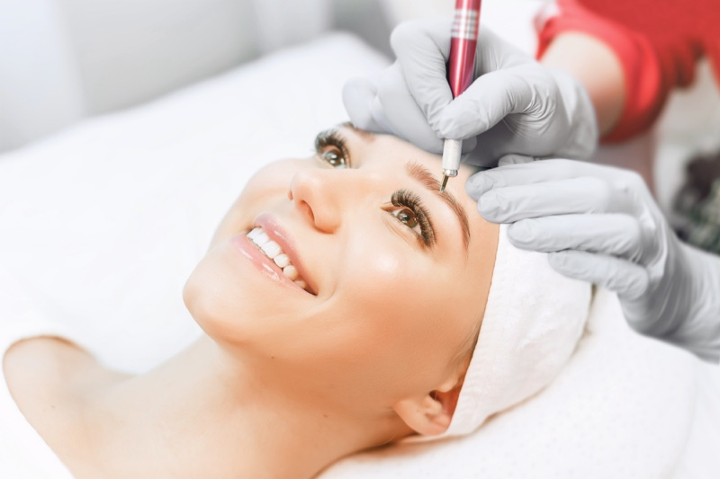Woman Smiling While Microblading