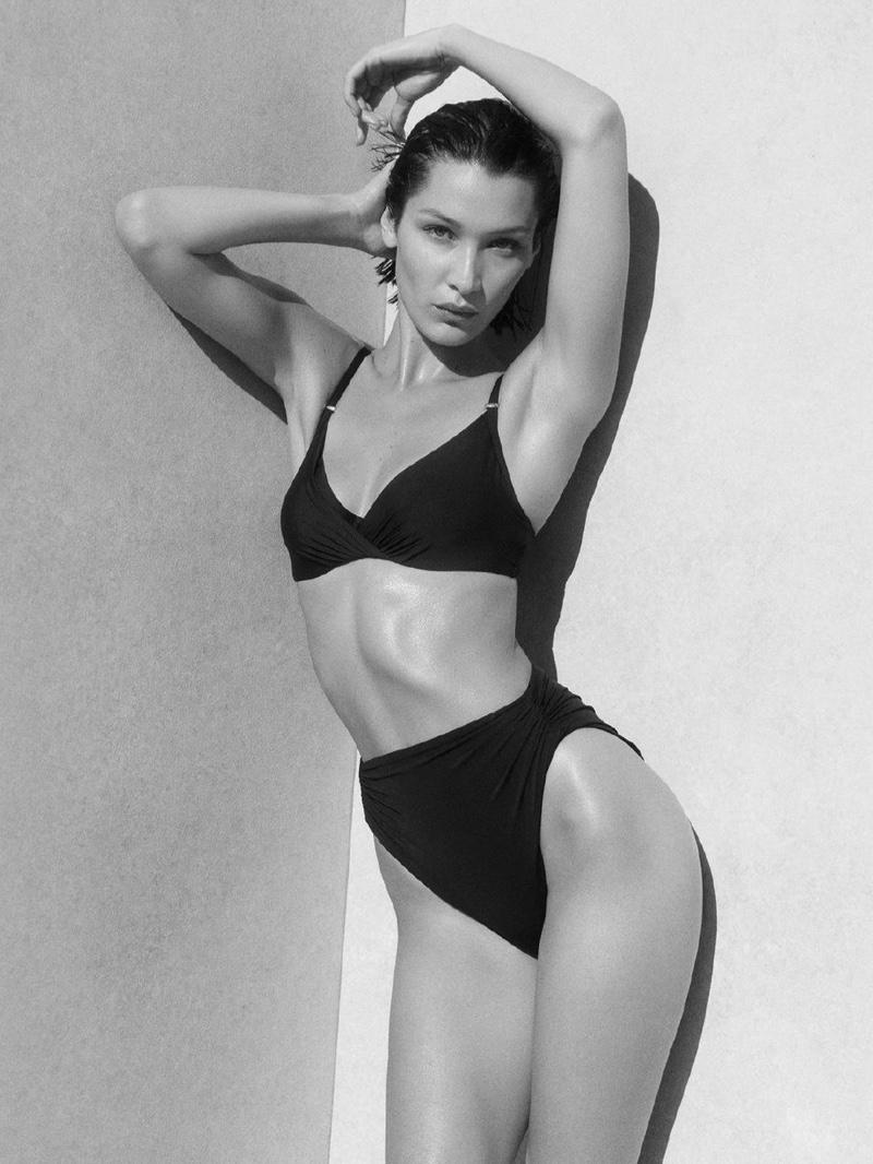 Showing off her bikini body, Bella Hadid fronts Calvin Klein swimwear summer 2020 campaign.
