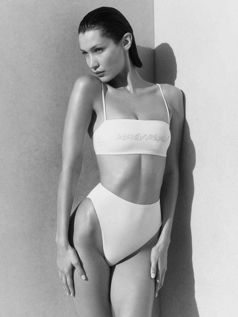 Bella Hadid rocks a white bikini in Calvin Klein swimwear summer 2020 campaign.