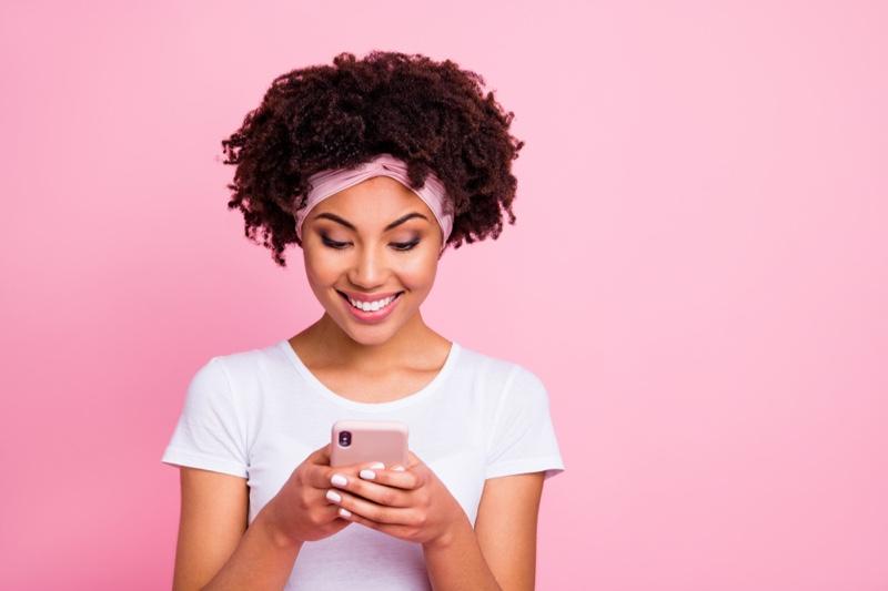 Black Model Afro Smiling Looking Phone