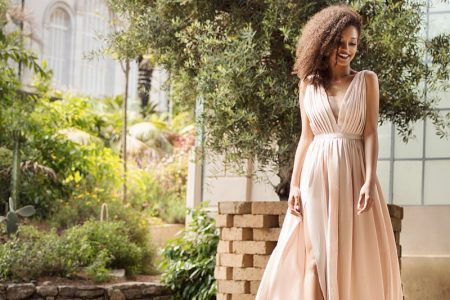 Black Model Outdoors Pink Pleated Dress Smiling