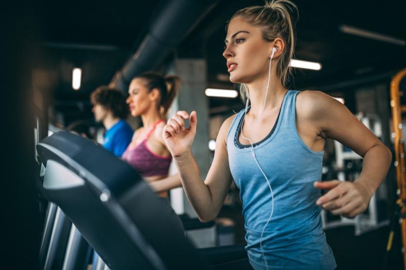 Blonde Woman Running Treadmill Earphones