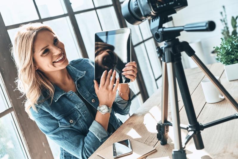 Blonde Woman Smiling Tablet Camera Influencer Setup