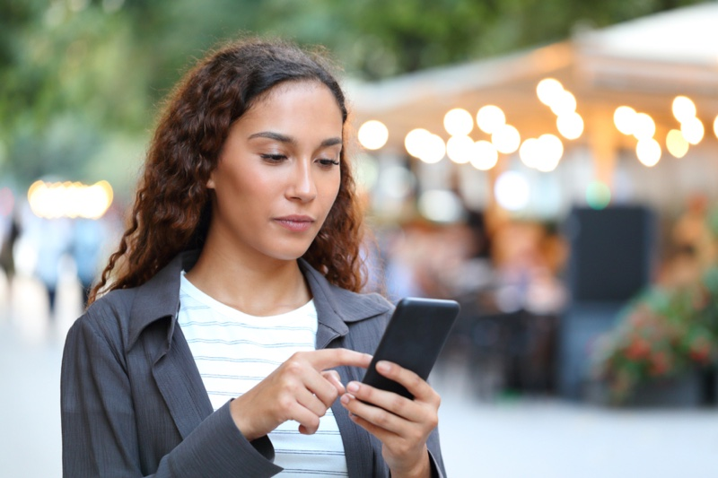 Brunette Woman Using Phone