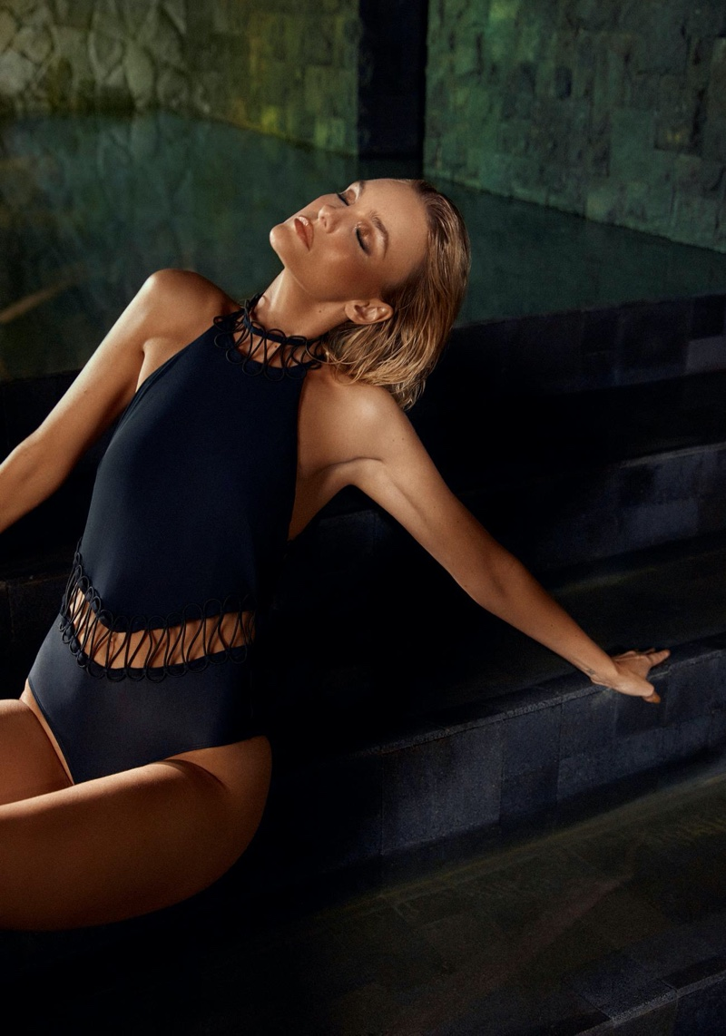 Wearing a one-piece swimsuit, Caroline Trentini poses in Agua de Coco swimwear 2020 campaign.