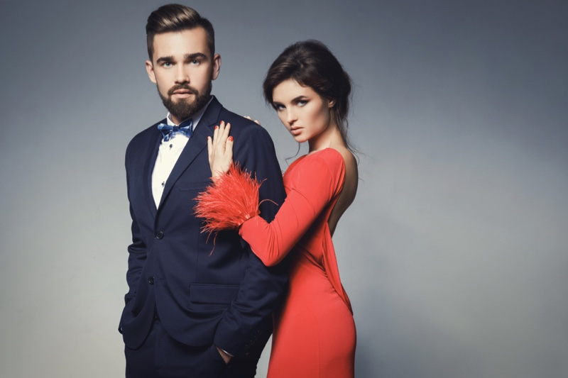 Couple Man Suit Woman Red Dress Feathers