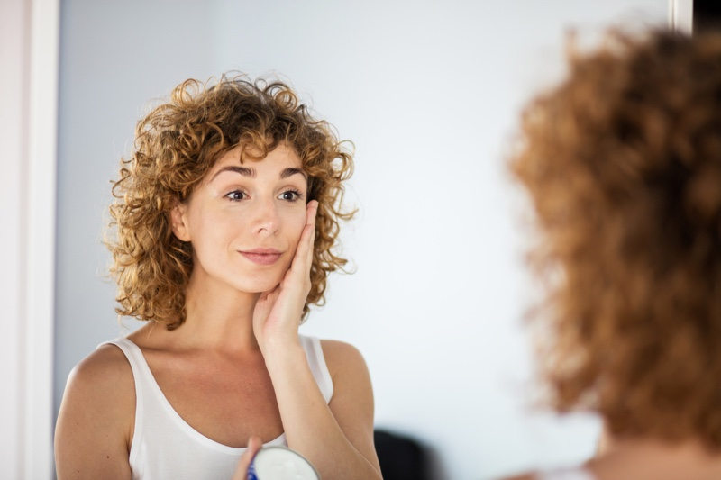 Curly Haired Woman Skin Mirror Older
