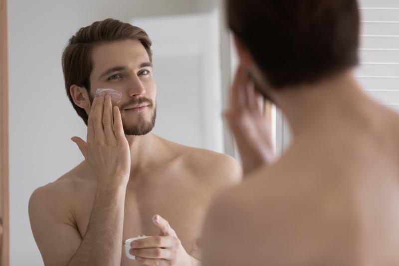 Man Applying Moisturizer Face Cream
